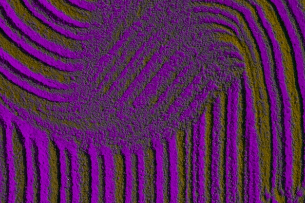 Randomly lines design in violet sand