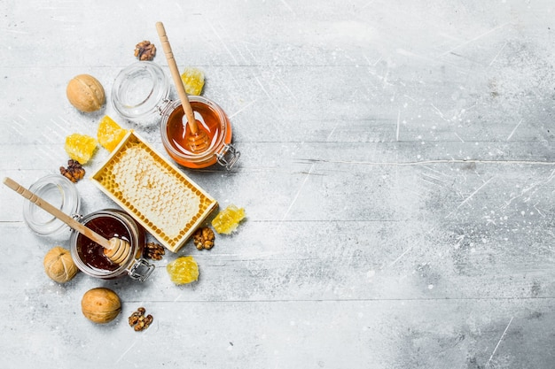 The range of types of natural honey. on a rustic background.
