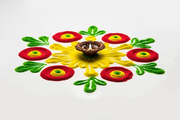 Rangoli design is an art form made during using powder colours during diwali, onam, pongal, hindu festivals in india