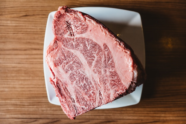 Rare authentic a5 grade japanese wagyu beef filet mignon with high-marbled texture.