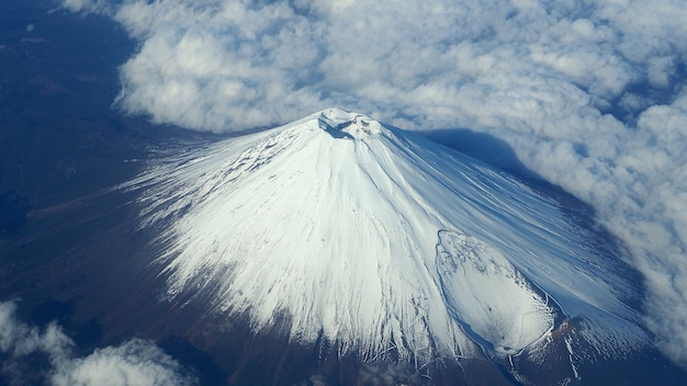 Rare images top view angle of mt. fuji mountain and white snow cover on it and light clouds and clear clean blue sky