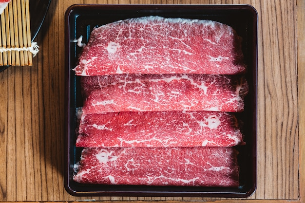Rare slices authentic a5 grade japanese wagyu beef with high-marbled texture for shabu.