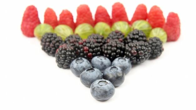 Raspberries, gooseberries, blackberries and blueberries on white background. tasty healthy vitamin food