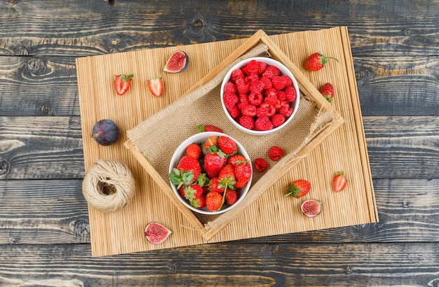 Raspberries in plate with strawberries and figs