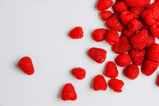 Raspberries top view on a white background