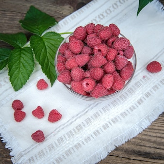 Raspberry berries in a glass bowl