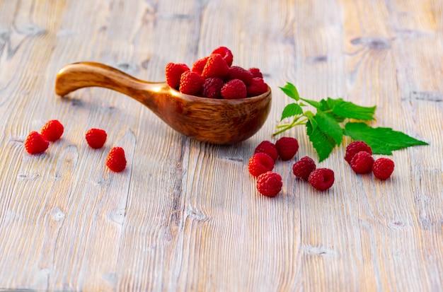 Raspberry berries on wooden background.