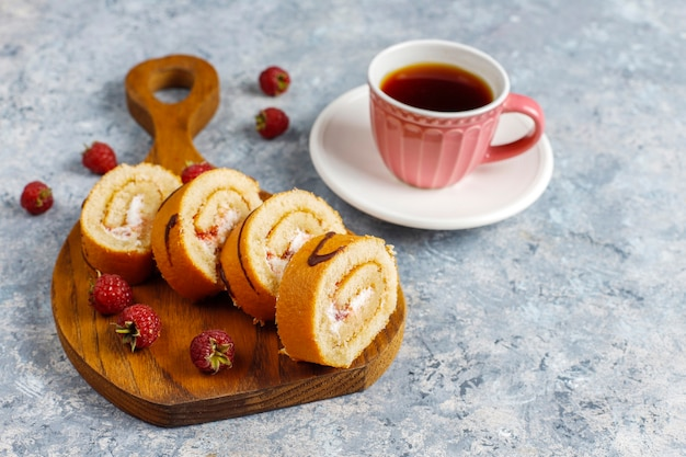 Raspberry cake roll with fresh berries.