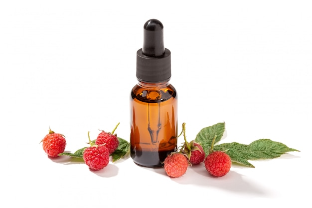 Raspberry essential oil isolated on white background
