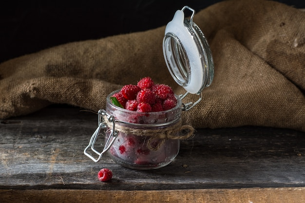 Raspberry in a glass jar. raspberry. healthy food concept. fresh organic berries. vegetari