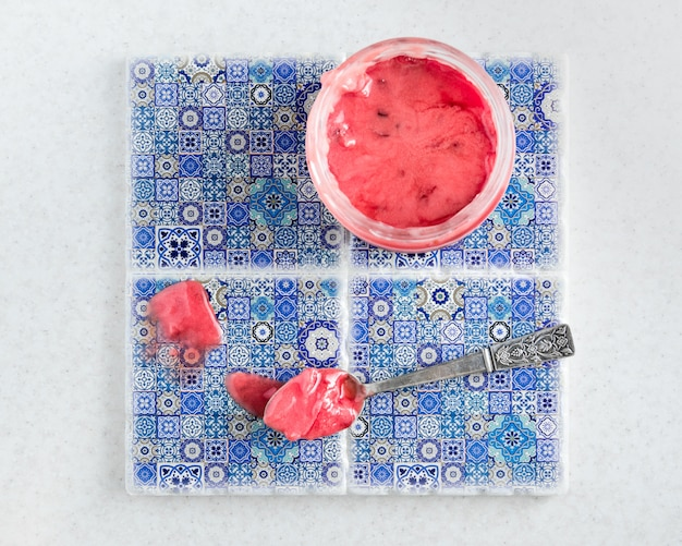 Raspberry honey on blue tile with small