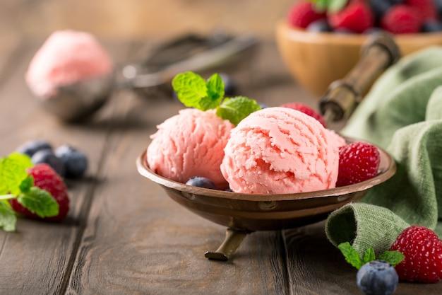 Raspberry ice cream in copper bowl.