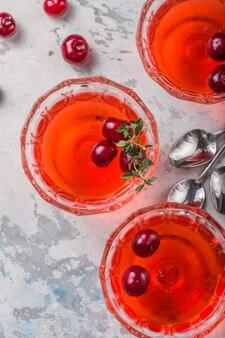 Raspberry jelly  with fresh raspberries