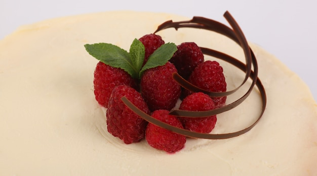 Raspberry lies on a cheesecake