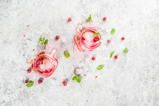 Raspberry sangria with fresh raspberry and syrup and mint leaves