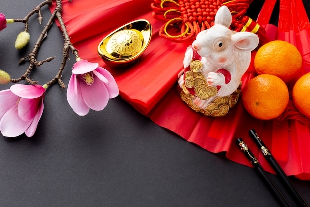 Rat figurine and magnolia chinese new year