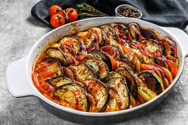 Ratatouille, homemade vegetable dish. vegetarian food. gray background. top view.