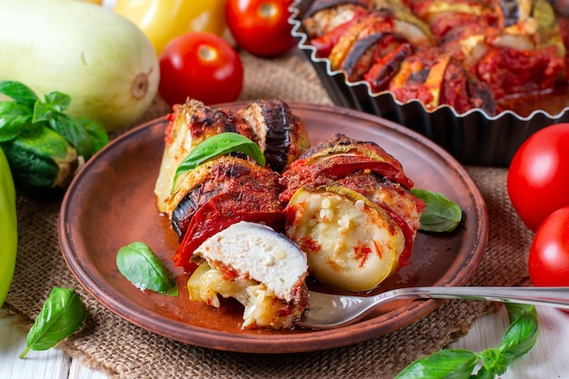 Ratatouille - traditional french provencal vegetable dish cooked in oven. diet vegetarian vegan food - ratatouille casserole.