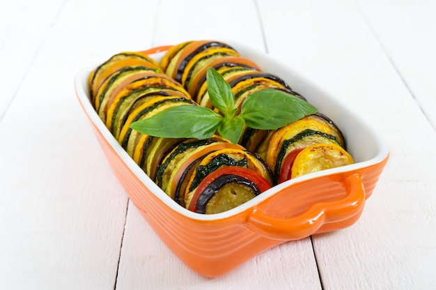 Ratatouille vegetable dish of zucchini, tomatoes and eggplant slices