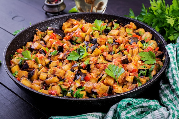 Ratatouille. vegetarian stew  eggplants, bell peppers, onions, garlic and tomatoes with herbs.