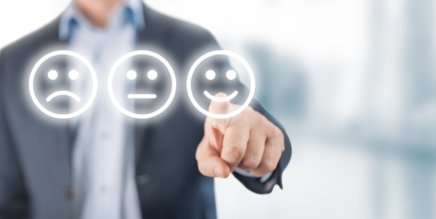 Rating concept. man choosing happy smile face emotion on blurry background