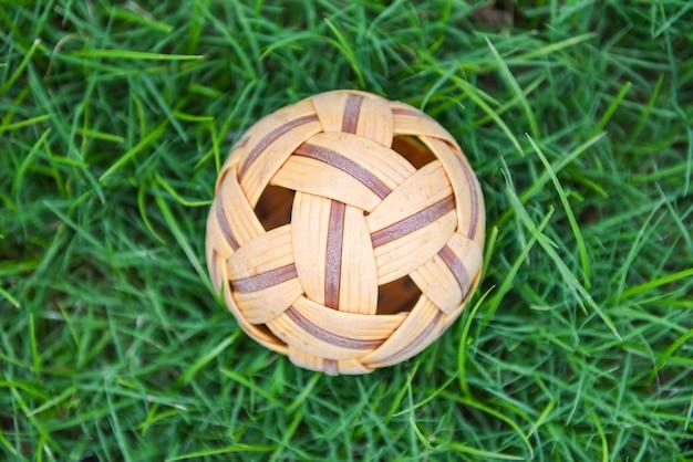 Rattan ball or takraw ball on green grass meadow