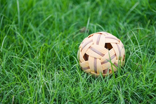 Rattan ball or takraw ball on green grass