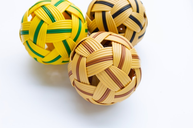 Rattan ball on white surface.