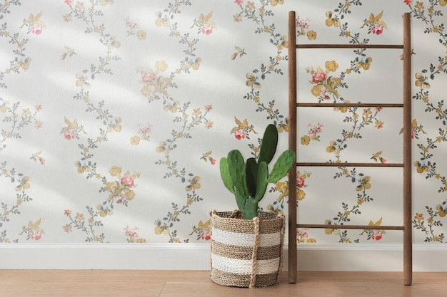Rattan basket by a floral wall background