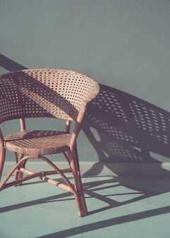 Rattan chair and on floor
