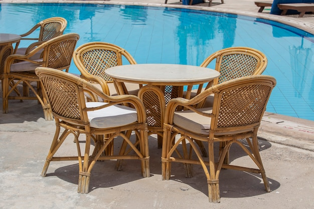 Rattan table and chairs in beach cafe near swimming pool in egypt