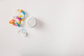 Rattle; pacifier and milk bottle isolated on white background