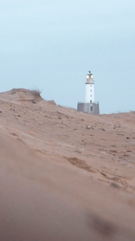 Rattray head lighthouse at aberdeenshire coast, scotland