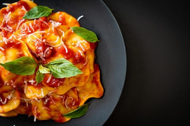 Ravioli with tomato sauce and basil - italian food style