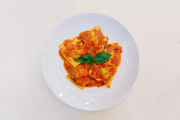 Ravioli with tomato sauce and basil.