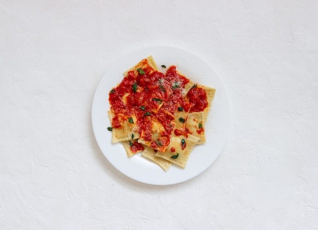 Ravioli with tomato sauce, spinach and parmesan cheese. healthy eating. vegetarian food. italian cuisine.
