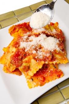 Ravioli with tomatoes sauce