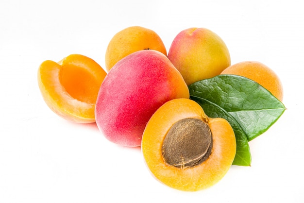 Raw apricots isolated on white