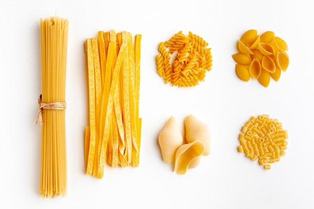 Raw assortment of pasta on white background