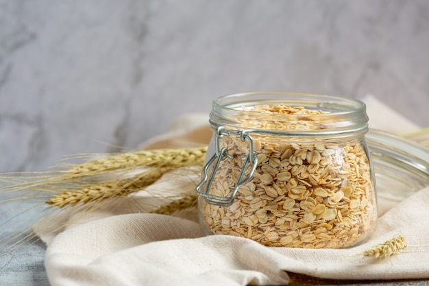 Raw barley grain in old dark background