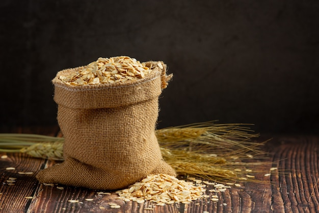 Raw barley grain in wooden background