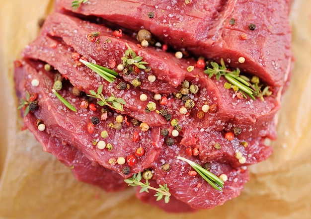 Raw beef fillet with pepper and thyme