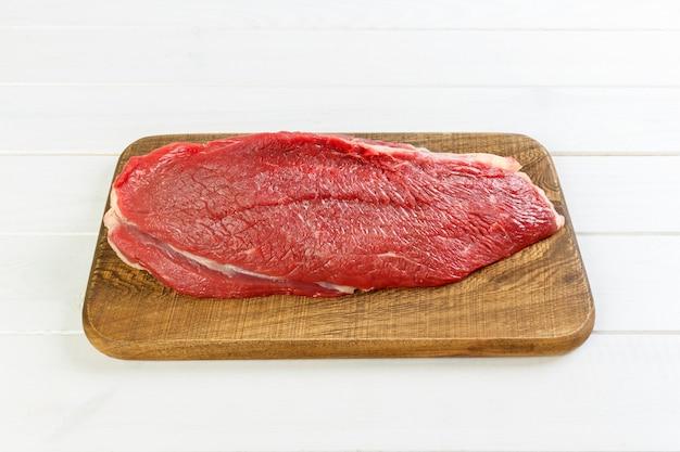 Raw beef meat: fresh beef pork big fillet on wooden board
