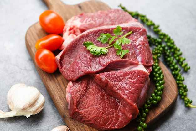 Raw beef meat on wooden cutting board
