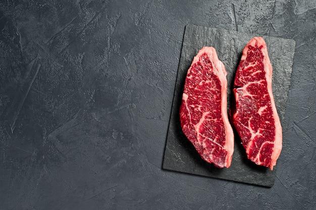 Raw beef ramp steak. copyspace