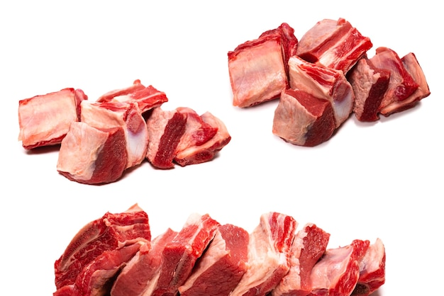 Raw beef ribs isolated on white background. top view.
