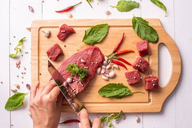 Raw beef on white wood background
