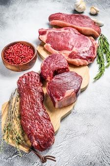 Raw black angus beef meat steaks  fillet mignon, rib eye, striploin