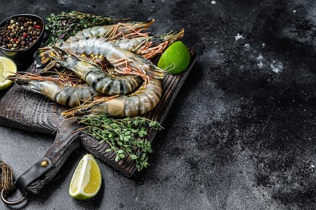 Raw black tiger prawns, shrimps and spices.
