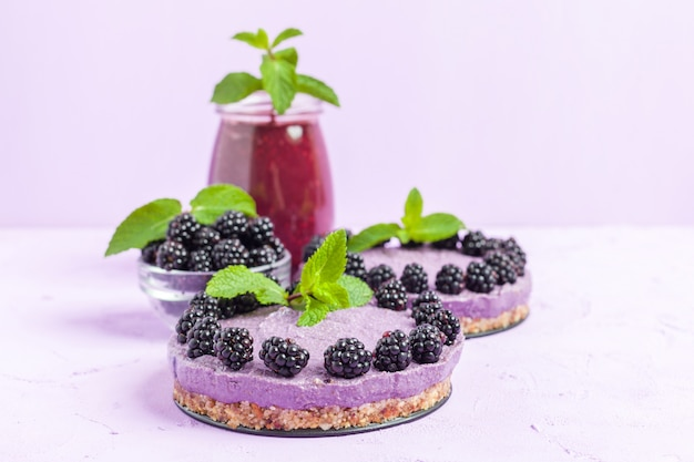 Raw blackberry dessert decorated with fresh ripe forest berries